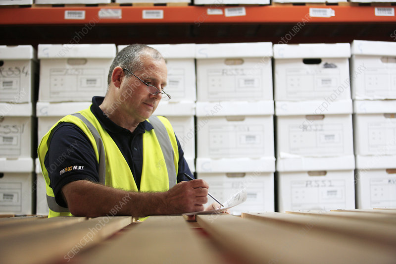 Worker in removals and storage facility