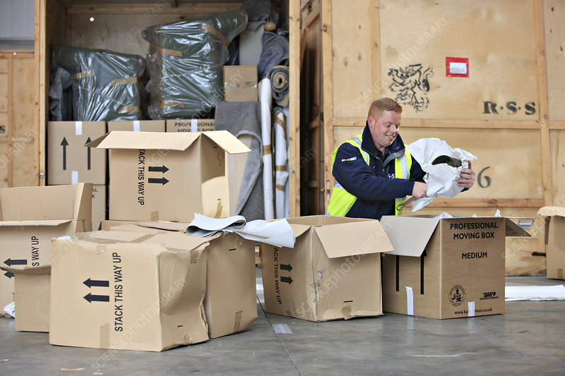 Packing boxes at removals and storage facility