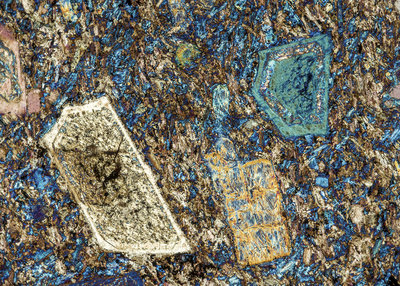 Andelatite mineral rock crystals, polarised light micrograph