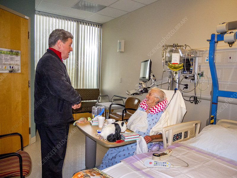 Priest Visits Hospital Patient