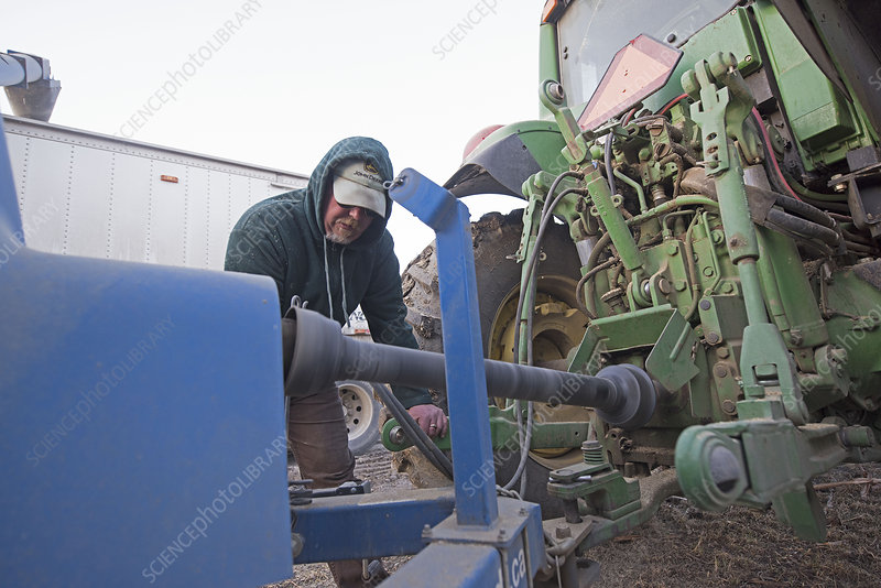 Farmer Repairing Farm Equipment