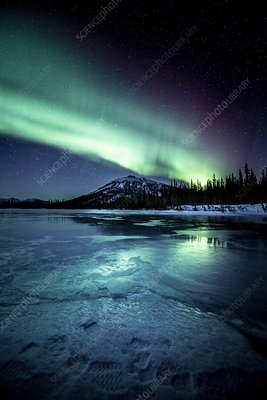 Aurora over a frozen river in Alaska, USA