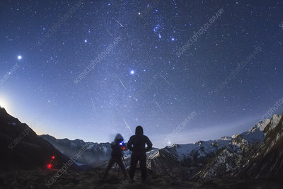 Geminid meteor shower over mountains in China