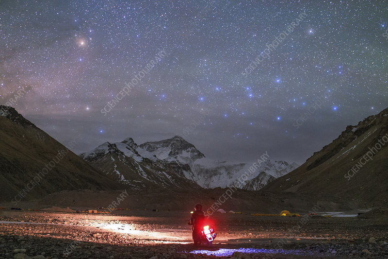 Motorcyclist and Mount Everest at night