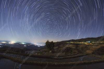 Star trails over rice terraces in China