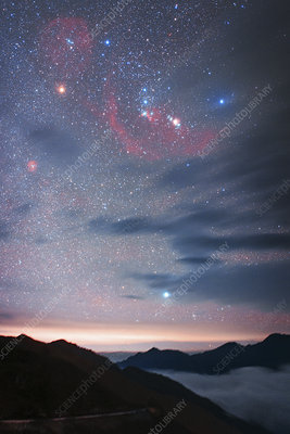 Orion in the night sky over mountains in China
