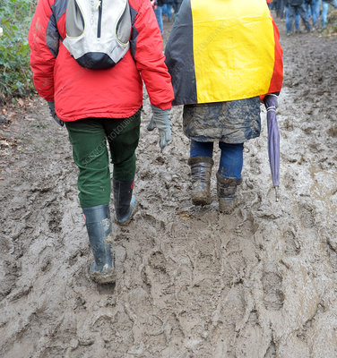 Walkers on muddy pathway