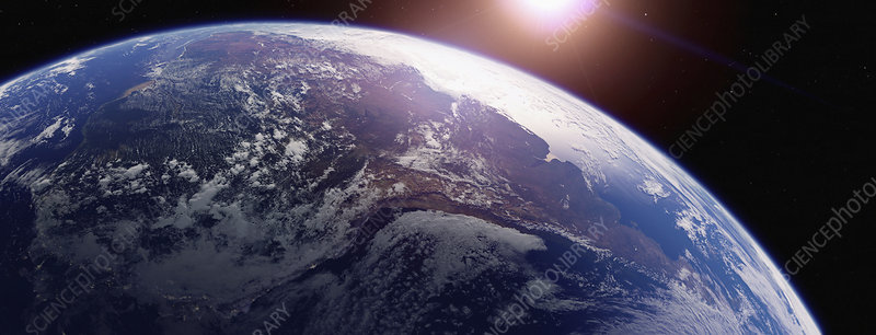 Sun rising over South America from space, illustration