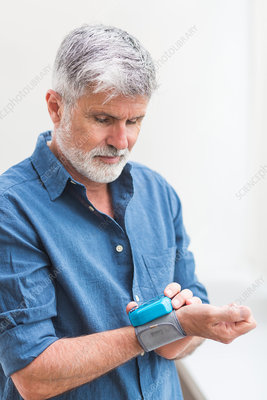 Man taking his blood pressure