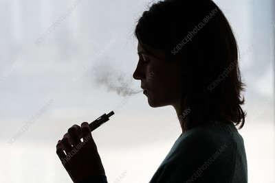 Woman using electronic cigarette