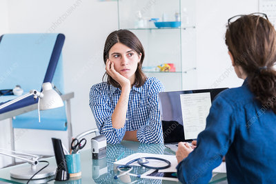 Doctor discussing with a female patient