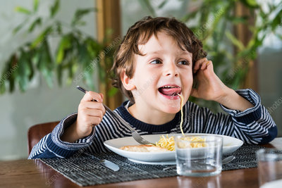 4 year-old boy eating
