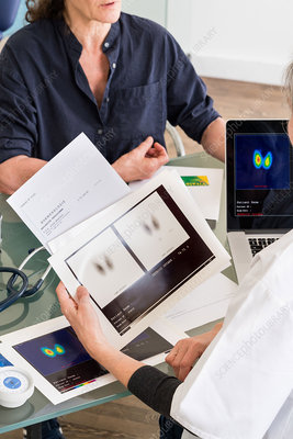 Doctor discussing thyroid scintigraphy with patient