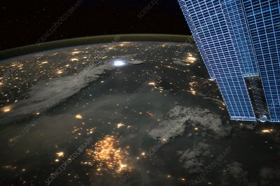 Lightning and city lights, ISS image