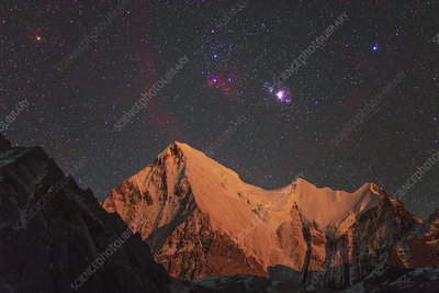 Orion stars and nebulae over Chana Dorje mountain