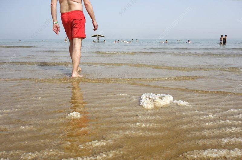 Bathers and salt, Dead Sea, Israel
