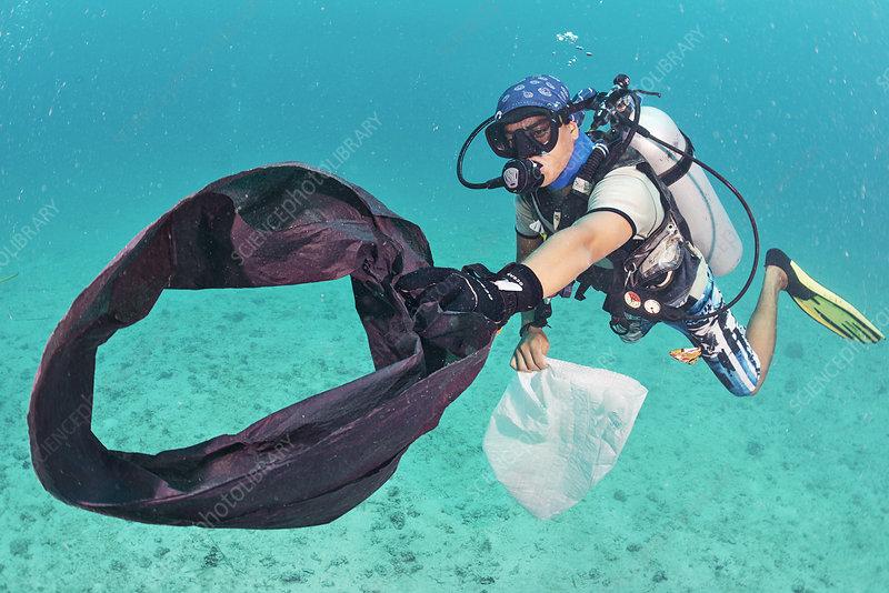 Scuba diver collecting plastic waste