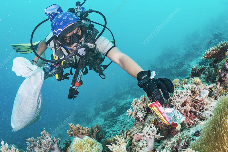 Scuba diver collecting waste food wrapper