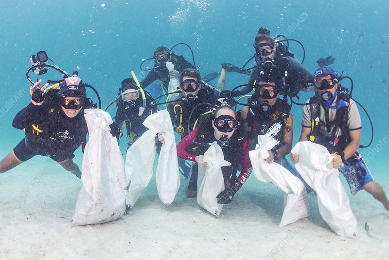 Scuba divers collecting plastic waste