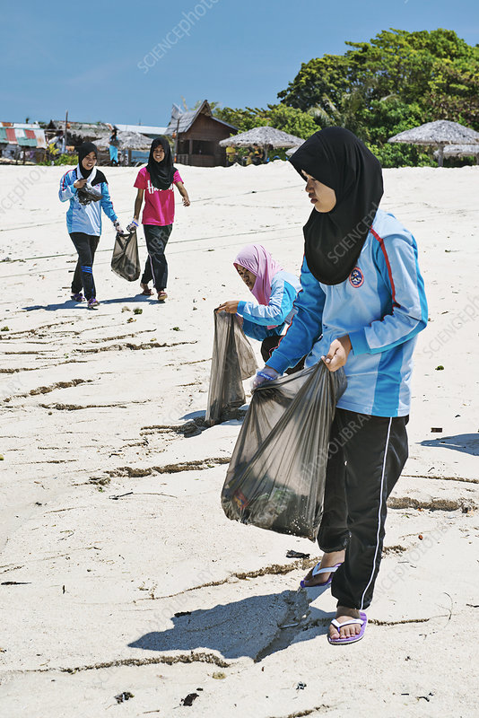Collecting waste on a beach