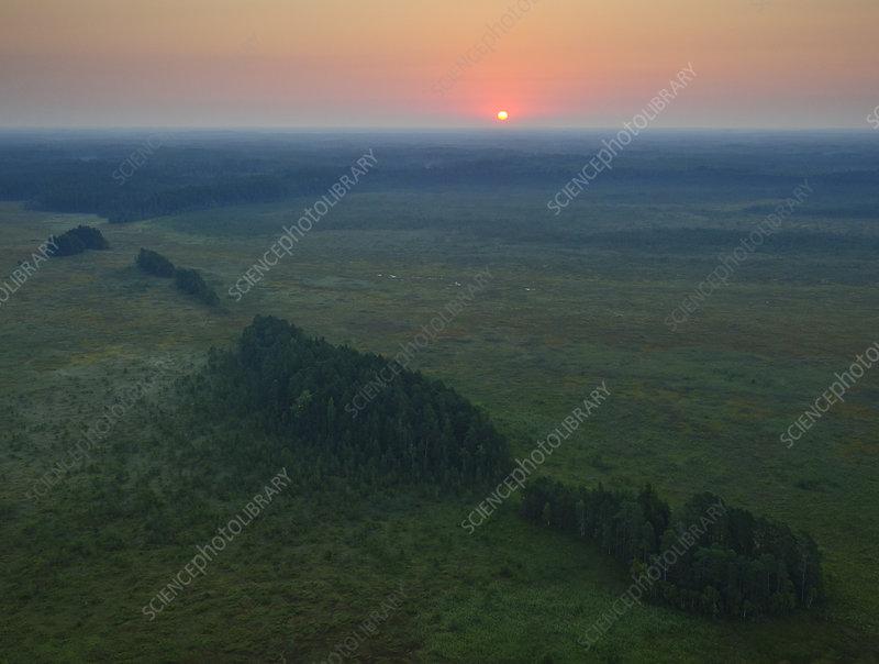 Sunrise over mineral islands in the Muraka bog, Estonia