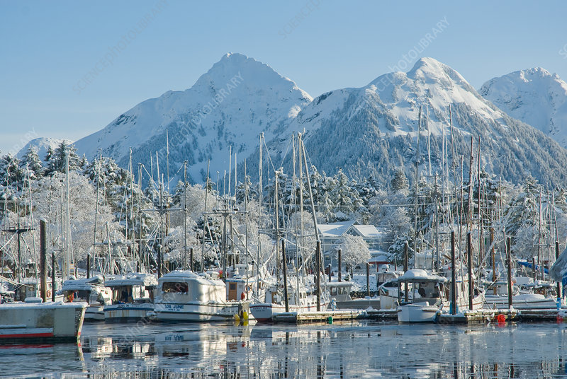 Snow covered fishing boats in Sitka Harbour, Alaska, USA