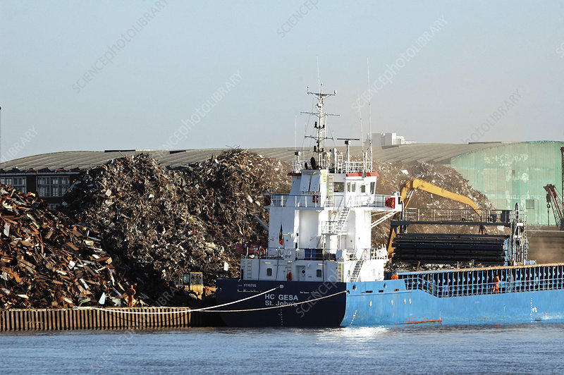 Boat loading or unloading scrap metal, River Thames, UK