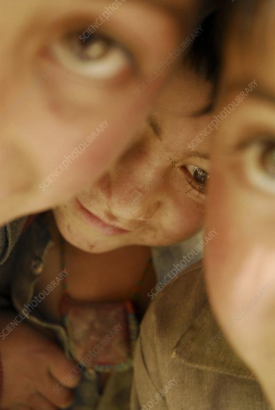 Close up portrait of three children, Askole village, Pakista
