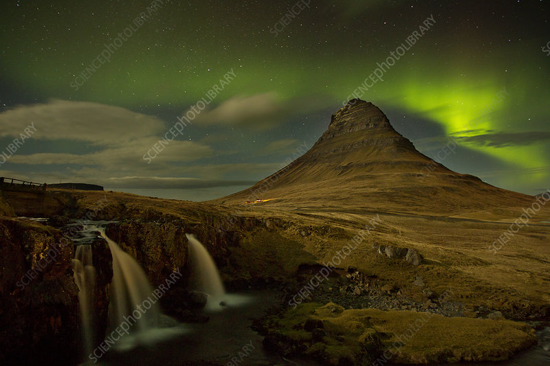 Aurora Borealis display over mountains at night, Iceland
