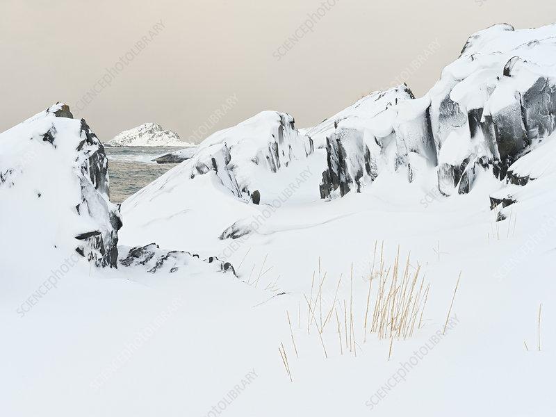 Rock formations in snowy winter landscape, Norway