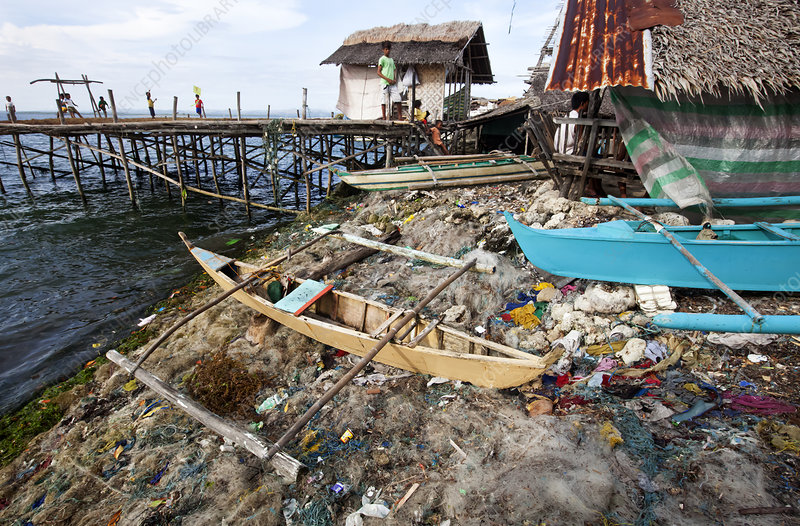 Discarded nets, bangka canoe and other garbage, Philippines