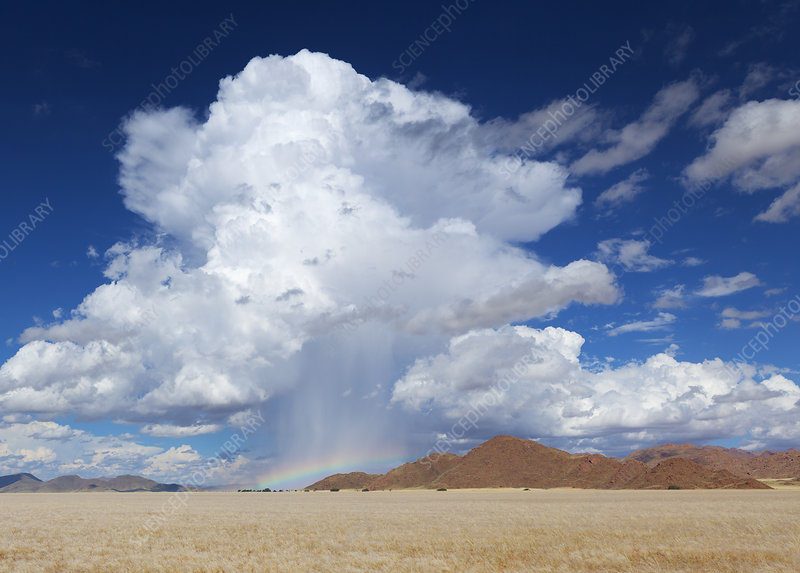 Cloud formation and downpour over a mountainous area