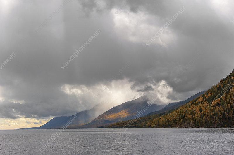 Clouds over lake shoreline
