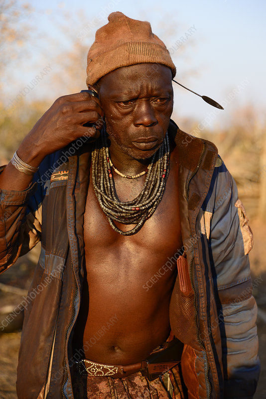 Himba man talking on a mobile phone