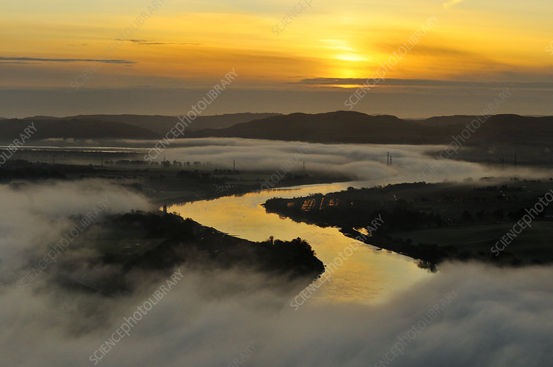 Misty morning looking down the River Tay in autumn, UK
