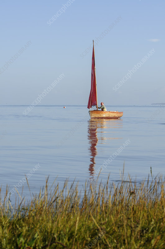 Small traditional sailing boat on the Thames Estuary, UK
