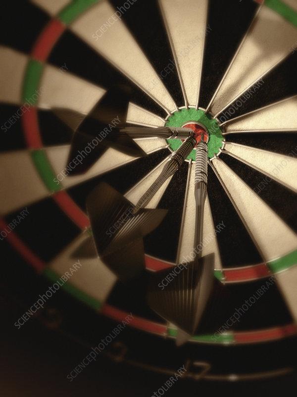 Three darts hitting bull's eye on dartboard, illustration