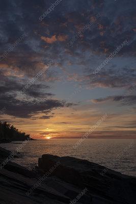 Sunset over Lake Superior shoreline
