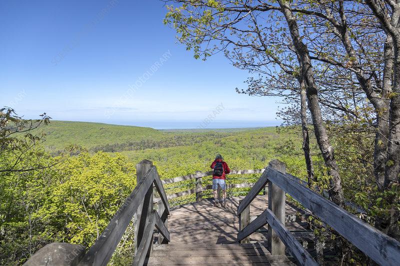 Hiker on Summit Peak, Michigan, USA