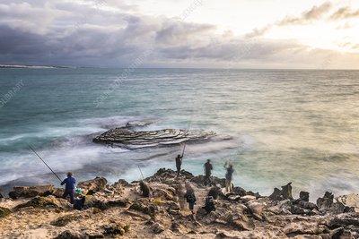 Fishermen on the coast at dawn