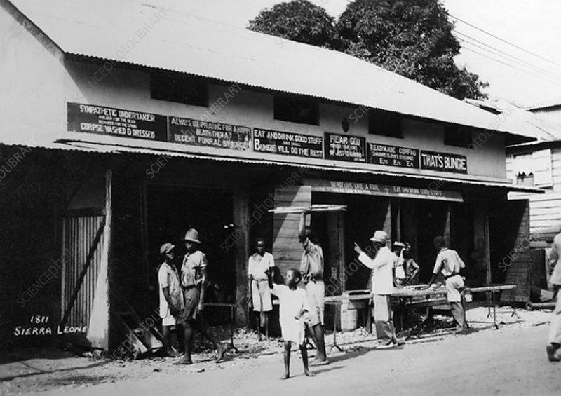 People outside an undertaker's, Sierra Leone, 20th century
