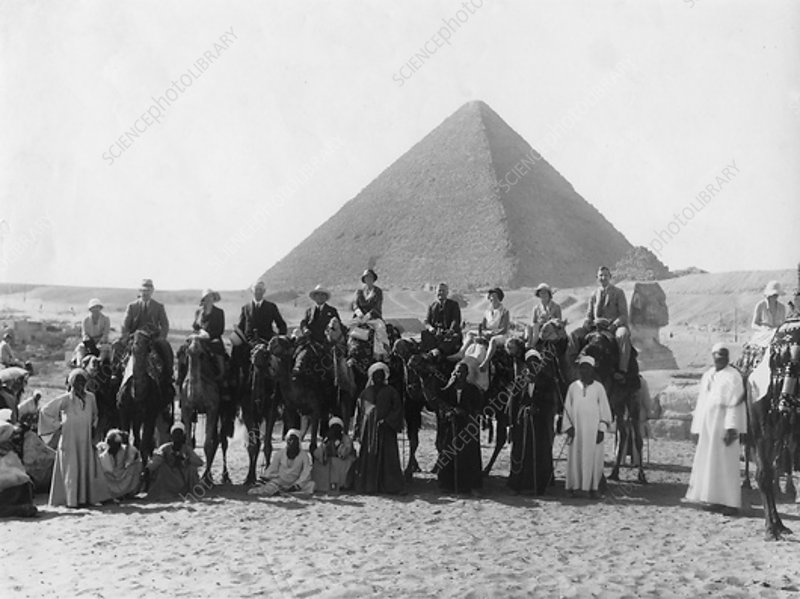 Camel tour in front of one of the Pyramids of Giza, Egypt
