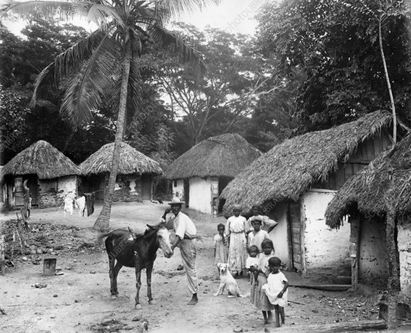 Family outside home, Coolie Street, Kingston, Jamaica, 1931