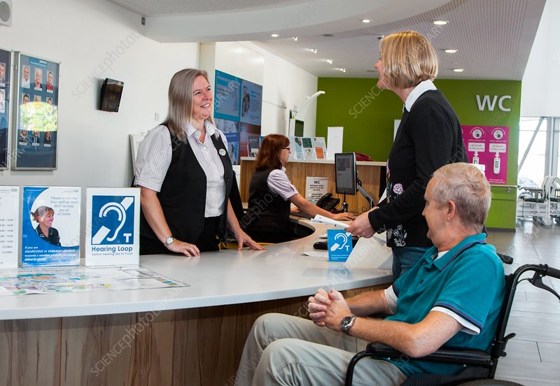 Patients at a hospital reception desk