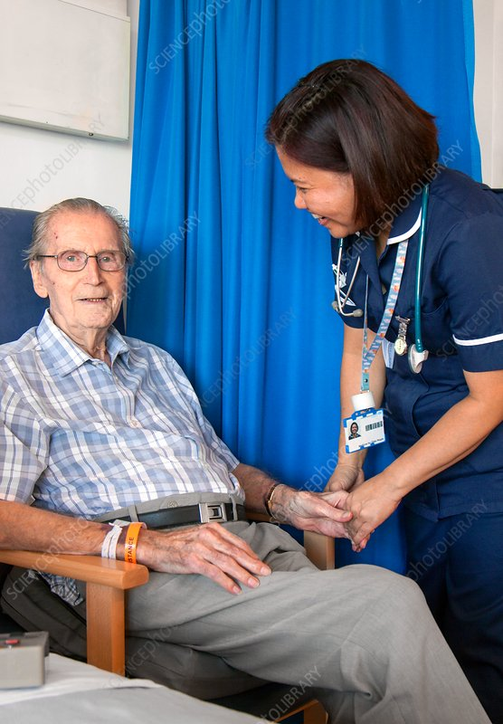 Elderly patient with hospital nurse
