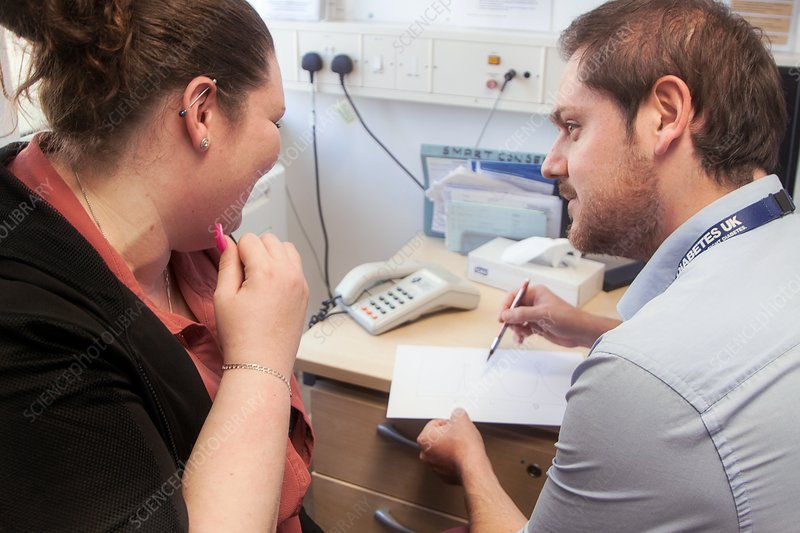 Diabetes consultant with patient