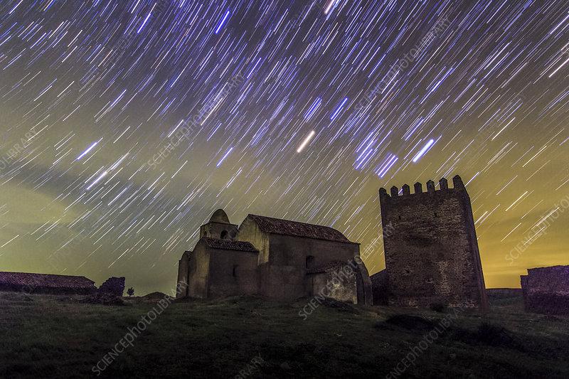 Star trails over Noudar Castle, time-exposure image