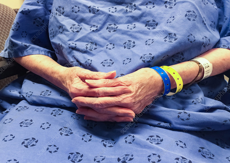 Elderly female patient in a hospital gown
