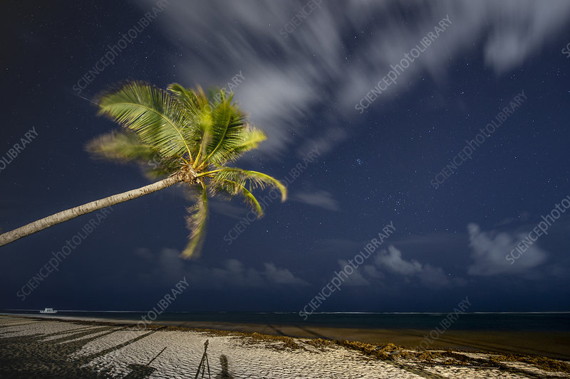 Clouds at night over a tropical beach