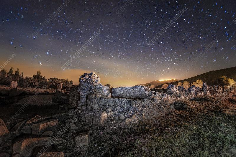 Night sky over Roman ruins
